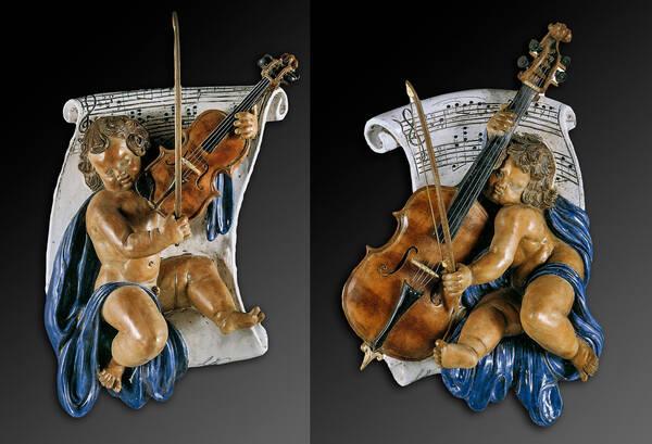 CEC-583/A Pair of Cherub Violinist Terracotta Plaques